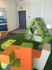 This little nook is where children can look at books and site on cushioned chairs. They can also sit in the mirrored book shelf.
