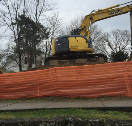 House being renovated in Larchmont- Contractors use a backhoe to dig out a new foundation