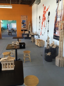 This Keva Planks area is well thought out with space for children to creat their own designs on their own tables. Designers have created some examples that children can look at and copy.